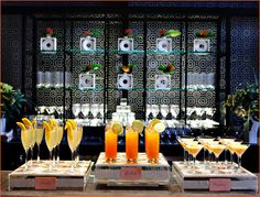 """A large cement and crystal bar held a display of orange-colored signature drinks:  • """"Preggatini"""" (Vodka, Triple Sec, Orange Juice, Cream)  • """"The Storkie"""" (Prosecco and Apricot Nectar)  • """"Lullaby"""" (Tangerine juice, club soda)"""