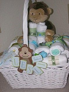 Diaper Gift Basket - I got the idea from the diaper cakes, each is decorated with a ribbon a charm and some scrap book scraps then each diaper has a gift such as travel wipes, soap, lotion, onsies, a gift cert, or candles for the new mom.