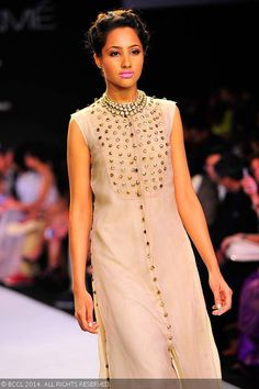 A model showcases a design by Jade Collection on Day 3 of the Lakme Fashion Week (LFW) Summer Resort 2014, held at Grand Hyatt, Mumbai, on March 13, 2014.