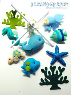 Title: Oceanography  Theme: Under the Sea, Ocean, Nautical  Featuring the exquisite under the sea friends: seahorse, turtle, goldfish, starfish, butterfly fish, clown fish, corals and the great whale for centerpiece! Whimsical decorative ideas for kids' playroom or baby nursery with Under the Sea theme, whales, nautical, aquatic, ocean, sea world, beach, aquarium.