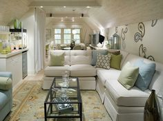 Great use of space with these slanted ceilings.  Candice Olsen design.