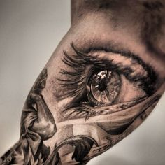 This awesome photo realistic eye tattoo is by Niki Norberg. The eye looks away from the viewer instead of making eye contact. Engel Tattoos, Tattoos Arm Mann, 3d Tattoos, Trendy Tattoos, Tattoo Drawings, Body Art Tattoos, Tattoos For Guys, Tattoos For Women, Tattoo Ink
