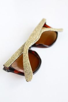 DIY glitter sunglasses... maybe i could do this with my scratched D's