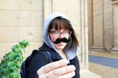 Photo paddles, to hold in front of the camera and give your subject an instant hat, red lips, or a mustache.