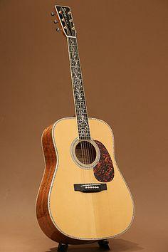 Martin Figured Koa-Special (2005) : Limited run of 25. Adirondack Spruce top, Highly Figured ''Blistered'' Koa back & sides.