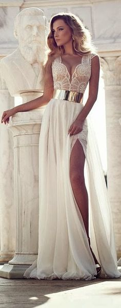 """Charming White Dress with Golden Belt."" Don't know about charming, but seal the neckline up a bit and no uber high leg slit and this would be a lovely wedding gown."