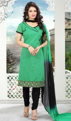 Look radiant and ravishing in this green color shade cotton churidar dress. The wonderful lace and resham work a considerable attribute of this attire. #LimeGreenAndBlackShadesDress