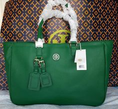 ROSLYN TOTE. COLOR: EMERALD STONE (301). EMERALD GREEN COATED CANVAS. POLISHED GOLD TONE TB LOGO. FULLY LINED IN SIGNATURE LOGO FABRIC. 1 LARGE ZIP POCKET. AND A GOLD TONE METAL TB LOGO! SORRY, NO DUST BAG. | eBay!