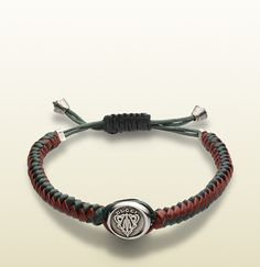 Gucci - woven leather bracelet with gucci crest tag 294685J89818521