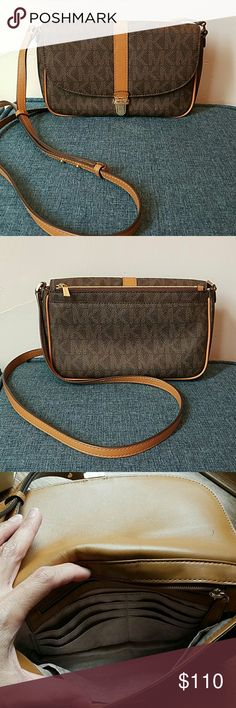 Michael Kors Charlton cross body purse Genuine Michael Kors cross body. Signature mk print in brown with camel color leather trim. Excellent condition with the exception of two very small ink pen marks on inside flap. Lots of storage. Inside zip pocket and card slots as well as outside zip pocket. Michael Kors Bags Crossbody Bags