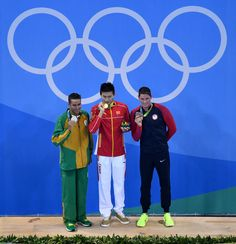 Silver medalist Chad le Clos of South Africa, gold medalist Yang Sun of China and bronze medalist Conor Dwyer of the United States poses on the podium during the medal ceremony for the Men's 200m Freestyle Final on Day 3 of the Rio 2016 Olympic Games at the Olympic Aquatics Stadium on August 8, 2016 in Rio de Janeiro, Brazil.