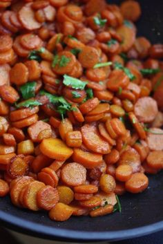 Spicy Moroccan Carrots: If you can't find harissa, simply substitute another hot sauce like siracha, or add ¼-1/2 teaspoons cayenne, depending on how much you like heat. 2 T. olive oil,  2 lbs carrots, peeled and thinly sliced, 1 t. cumin, ½ t. paprika, ½ t. turmeric,  ½ t. salt, 1 t. harissa, 2 t. honey, ½ lemon, 1/2 c. cilantro leaves, chopped.