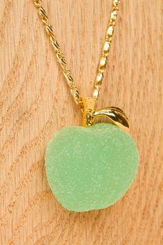 q-pot.  apple pendant necklace.  pvc and brass.