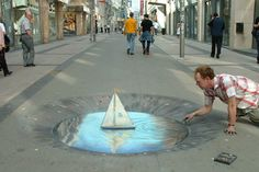"Julian Beever is an English artist famous for his art on the pavement of England, France, Germany, USA, Australia and Belgium. He gives his drawings an anamorphoses. The images are drawn completely ""deforms"" which give a 3D image when viewing at a specific angle."