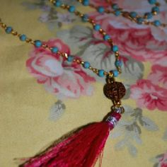"""Mala Bead Tassel Necklace Beautiful turquoise and gold colored mala bead necklace with a vivid pink tassel. Lobster clasp closure. Necklace measures 18"""" long. New without tags.  Tags: festival, boho, bohemian, hippie Jewelry Necklaces"""