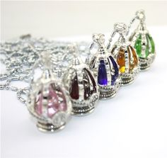 Puella Magi Madoka Magica Soul Gem Necklace. Can't decide between the blue and the red!