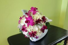 Bridesmaid's bouquet of white hydrangea, purple dendrobium orchids and dusty miller by Beautiful Blooms by Jen.