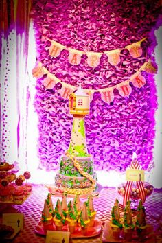 Ruffles backdrop and very nice high tower cake. Very elegant party details.