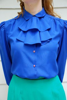 Hey, I found this really awesome Etsy listing at https://www.etsy.com/listing/154343794/vintage-peacock-blue-secretary-blouse