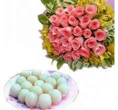 A bouquet of Pink Roses with Rasgulla.