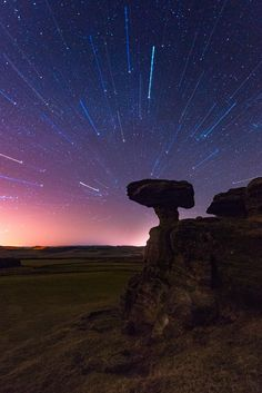 Gravitation - The Bunnet Stane (or Bonnet Stone) is an amazing rock formation in the middle of the fields in Fife in Scotland. An elevated table rock sits on a thin column and looks like a giant mushroom. For this photo I used a quite creative technique called Zoom burst that requires shooting two images separately which are later combined together in Photoshop.