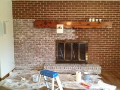 White washing was done with sponge & semi gloss latex white ceiling paint… Update Brick Fireplace, White Wash Brick Fireplace, Brick Fireplace Wall, Painted Brick Fireplaces, White Brick Walls, Fireplace Remodel, Living Room With Fireplace, My Living Room, Fireplace Ideas
