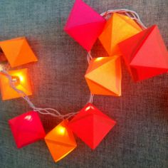 Twinkle light covers!  Another way to use the prism shapes from the Geometric Decor workshop.