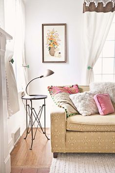 Beautiful vintage inspired living room. Love the drapes & tie backs, the lamp, and those darling pillows too!