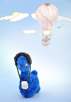 """Blue amigurumi dinosaur doll, crochet handmade.  This doll, named Fuzz, is a great gift for children and babies. It comes with attached headphones and an MP3 player. It is made of cotton acrylic blend yarn, polyester fiberfill stuffing.    Approx 9"""" tall (23cm).    Fuzz is a travelling dinosaur. He loves music and he travels around the world looking for new tunes. He loves meeting new friends.        Handmade with love and care in a smoke-free, pet-free zone.  You can hand wash the doll, do…"""