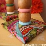 Cheery Mod Podge candlestick holders made from old crib parts.