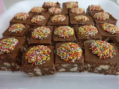 No-Bake Chocolate Slice Recipe. packet of plain biscuits (such as Milk Arrowroot or Marie) ¾ cup desiccated coconut cup cocoa powder, sifted 1 tin sweetened condensed milk Yummy Treats, Delicious Desserts, Sweet Treats, Yummy Food, Biscuit Cake, Biscuit Recipe, No Bake Slices, Baking Recipes For Kids, Cake Stall