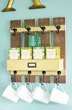 Concept for hanging storage over coffee/tea station - hooks for mugs, rack to store the small glass bottles of sugar, coffee, teabags and milo.  Another rack rather than hooks to store teaspoons?