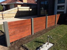 Horizontal merbau dividing feature fence with exposed posts