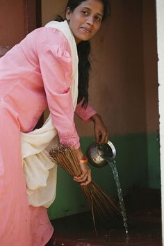 This woman cleans her new household latrine in India. She was able to construct it with help from a WaterCredit loan, which now brings safety, privacy, health, and dignity to her entire family. Thank you for helping make projects like this possible.