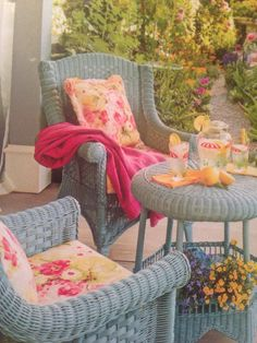 """Ideas to repaint wicker furniture on outside deck.  I love the color of the wicker and the fabric.    From Romantic Country magazine Spring 2014 issue - """"Happy Vintage"""" written by Khristi S. Zimmeth, Photography by Mark Lohman and Styling by Sunday Hendrickson."""