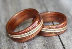 Hawaiian Koa Rings with spiraled inlays of beach sand bordered by Birch Wood…