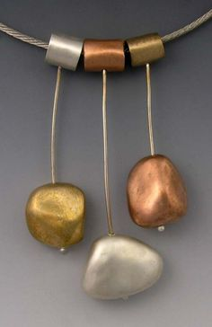 Hadar Jacobson, Pending Rocks, Silver, copper, and bronze clay. Stainless steel cable, 16 long.