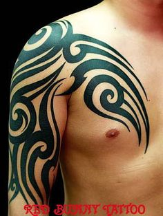 tribal・tattoo. Unless you have Samoan background or something of that nature, don't do this. Not very original and no, it doesn't make you look tuff