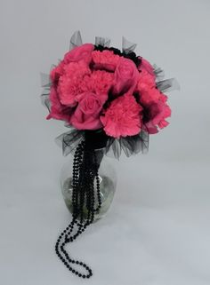 Hot Hot pink roses and carnations with black tulle and black beads! Perfect for a wedding in the middle of a baseball field!