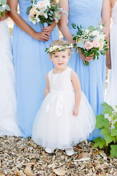 Little flower girl in pure white, leafy flower crown // Megan Clouse Photography