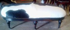 """Bruce designed and built this ottoman with the vision of using a large black and white HOH {Hair on Hide} to upholster it. He is soooo creative!!!!!! 60""""L x 33""""W x 19""""H ~ Signed and dated too! $575.00 — at B & S Furniture."""
