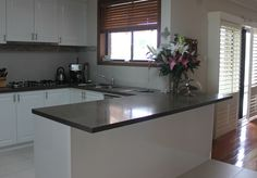 Kitchen Renovation with 2-Pak gloss white doors and Cesar stone benchtop