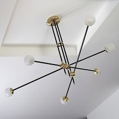 A mass of deconstructed pipes come together in the Intueri Light Bullarum ST-6 Chandelier, joining six solid brass rods in an off-center yet stable configuration. A perfect example of Intueri's modular design system, handcrafted joints, metal and hand-blown glass diffusers seamlessly connect and accent one another, culminating in an intuitive design with bright illumination. Suspended from three solid downrods, each brass hub acts as a pivoting axis for the three pipes and six light sources…