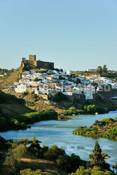 The historical village of Mértola, overlooking the Guadiana river. Guadiana Valley Natural Park, Alentejo, Portugal, via Cila Rato De Andrade De Koning Portugal Vacation, Places In Portugal, Visit Portugal, Spain And Portugal, Portugal Travel, Spain Travel, Algarve, Places To Travel, Places To Go