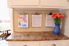 Organize your paperwork with DIY clipboards, one for each family member. Follow the tutorial to personalize it for each person.