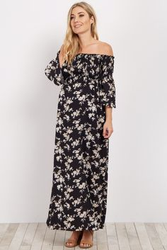 This gorgeous maxi is going to be your new favorite maternity dress. A smocked bust and chic boho style give this maternity maxi dress a stylish look. Pair this dress with a neutral sandals and a choker for a trendy look.