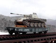 "WWII German Pz V Panther Tank transported on a DR 50 ton Flat Wagon Type SSys ~ WWII German Deutsche Reichsbahn railways (DR) 50 ton heavy 4-axle 2 Rail ""O"" Scale wagon type SSys transporting a Pz V Panther tank."