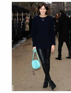 Alexa Chung wearing Burberry leather trousers and bag for the Burberry show during London Fashion Week. February 2011