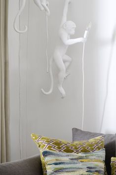 The seletti monkey lamp creates a fun and dynamic atmosphere in any space its placed in, we used this when tasked with the interior design of a young family home. A creative lighting idea for the living room corner.  #uniquelighting #lighting #lightingdesign #funlighting #childrenslight #creativelighting #lightingfixture...