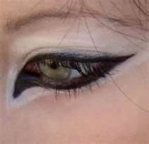 wolf eye makeup. lol i would laugh if I saw someone wearing this.